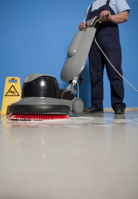 A person cleaning a floor