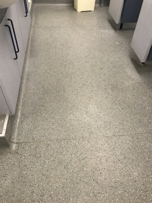 Another photo of a floor before it was cleaned
